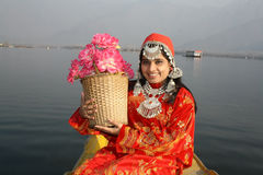 North Indian Girl Holding a Flower Basket. Very beautiful Kashmir girl in 20s holding a flower basked sitting on a Shikara and Dal Lake (North India) as Royalty Free Stock Photos