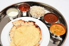 North Indian Thali. Delicious North Indian Thali with 2 curries, rice, pickle and yogurt Stock Images