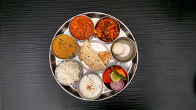 North indian thali. Basmati rice, dal , paneer , dahi and papad are aranged in thali Royalty Free Stock Image