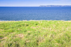 North Irish landscape with grazing in the foreground Royalty Free Stock Images