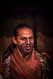 NORTH ISLAND, NEW ZEALAND- MAY 17, 2017: Close up of a Maori man with traditionally tatooed face and in traditional. Dress at Maori Culture, Tamaki Cultural Stock Image