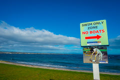 NORTH ISLAND, NEW ZEALAND- MAY 18, 2017: An informative sign of swim only zone not boat located at Taupo,New Zealand Stock Image