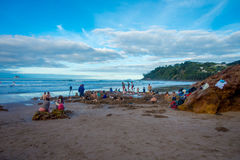 NORTH ISLAND, NEW ZEALAND- MAY 16, 2017: Tourists digging their own hot springs in Hot Water Beach, Coromandel. 130,000. Annual visitors make it one of most Royalty Free Stock Photography