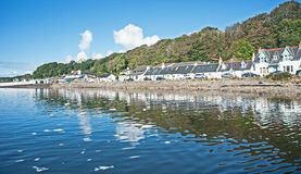 North Kessock. Hotel viewed from off shore in the Beauly Firth, Scottish Highlands, background of woods and trees royalty free stock photos
