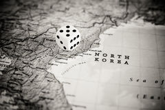 North Korea challenge of international war concept. Dice on map with North Korea country, concept of risk of war and risky challenge between nations stock photo