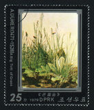 NORTH KOREA - CIRCA 1979: A post stamp printed in North Korea shows A Big Tuft of Grass by Albrecht Durer, circa 1979. Royalty Free Stock Image