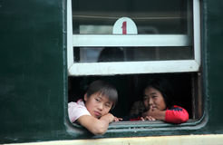 North Korea 2013. North Korea domestic passengers on the train.They are watching from the window next to the Chinese international trains Stock Photography
