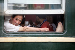 North Korea 2013. North Korea domestic passengers on the train.They are watching from the window next to the Chinese international trains Stock Images