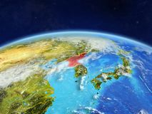 North Korea on Earth from space. North Korea on planet Earth with country borders and highly detailed planet surface and clouds. 3D illustration. Elements of royalty free stock image