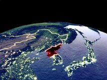 North Korea on Earth from space. North Korea from space on planet Earth at night with bright city lights. Detailed plastic planet surface with real mountains. 3D vector illustration