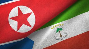 North Korea and Equatorial Guinea two flags textile cloth, fabric texture. North Korea and Equatorial Guinea two folded flags together stock illustration