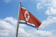 North Korea Flag with Clouds Royalty Free Stock Photos