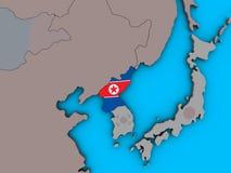 North Korea with flag on 3D map. North Korea with embedded national flag on blue political 3D globe. 3D illustration royalty free illustration