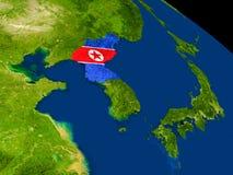 North Korea with flag on Earth Stock Image