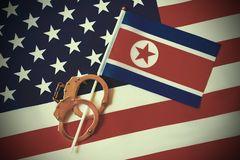 Flag of USA and North Korea. Handcuffs. Sanctions. North Korea flag in handcuffs on the background of the American flag. US sanctions against North Korea royalty free stock image