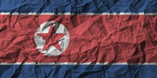 North korea flag with high detail of crumpled paper. 3D illustration Stock Photos