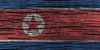 North korea flag with high detail of old wooden background. 3D illustration Stock Photography