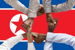 North Korea flag, intergration of a multicultural group of young people.  royalty free stock image