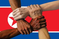 North Korea flag, intergration of a multicultural group of young people.  stock photos