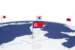 North Korea flag. Country flag with chrome flagpole on the world map with neighbors countries borders. 3d illustration rendering flag Royalty Free Stock Photo