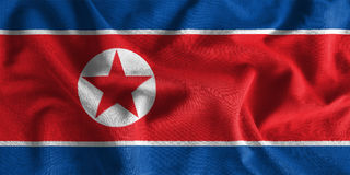 North korea flag painting on high detail of wave cotton fabrics. 3D illustration Stock Photos
