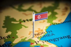 North Korea marked with a flag on the map.  stock photos