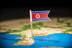 North Korea marked with a flag on the map.  royalty free stock photography
