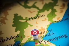 North Korea marked with a flag on the map.  royalty free stock photos