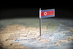North Korea marked with a flag on the map.  stock image