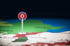 North Korea marked with a flag on the map.  royalty free stock photo