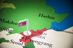 North Korea marked with a flag on the map.  stock photo