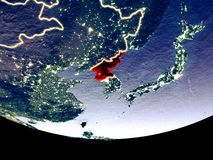 North Korea at night from space. Satellite view of North Korea from space at night. Beautifully detailed plastic planet surface with visible city lights. 3D royalty free illustration