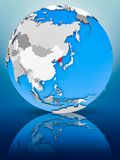 North Korea on political globe. North Korea on globe reflecting on surface. 3D illustration royalty free stock photography