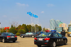North Korea, Pyongyang, April 11 2012 - cars, police and people Stock Photography