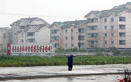 North Korea sinuiju  2013. Here is North Korea sinuiju streetscape in the rain.Gray building , political slogans and Royalty Free Stock Photography