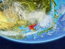 North Korea from space on Earth. North Korea on realistic model of planet Earth with country borders and very detailed planet surface and clouds. 3D illustration royalty free illustration