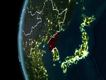 North Korea from space at night. Orbit view of North Korea highlighted in red with visible borderlines and city lights on planet Earth at night. 3D illustration stock photography