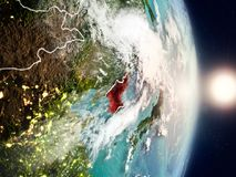 North Korea during sunrise. Highlighted in red on planet Earth with visible country borders. 3D illustration. Elements of this image furnished by NASA stock photo