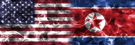 North Korea and United States of America smoke flag.  Stock Image