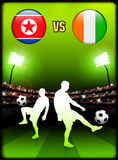 North Korea versus Ivory Coast on Stadium Event Background Royalty Free Stock Photos