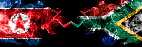 North Korea vs South Africa, African smoky mystic flags placed side by side. Thick colored silky smoke flags of North Korea and. South Africa, African stock illustration