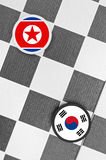 North Korea vs South Korea. Draughts (Checkers) - North Korea vs South Korea. Conflict between states. Threat of nucleat attack royalty free stock photography