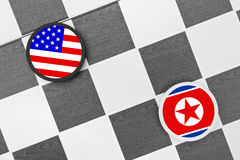 North Korea vs South Korea. Draughts (Checkers) - North Korea vs South Korea. Conflict between states. Threat of nucleat attack royalty free stock images