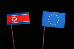 North Korean flag with European Union EU flag  on black Stock Image