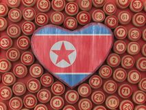 North Korean flag painted on the heart. North Korean flag painted on the wooden heart stock photos