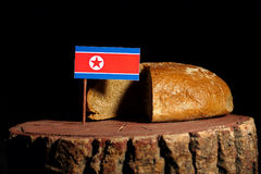 North Korean flag on a stump with bread Royalty Free Stock Image