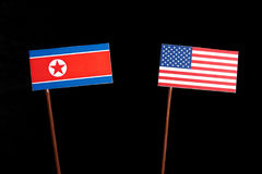 North Korean flag with USA flag on black. Background royalty free stock photography
