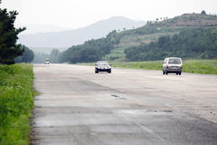 North korean highway. From Pyongyang to Kaesong.It was built between the mountainous area Stock Photos