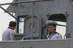 North Korean marine officer on USS Pueblo. A North Korean officer standing on top of the US spy ship USS Pueblo. USS Pueblo was entered by North Korean marine Royalty Free Stock Photos