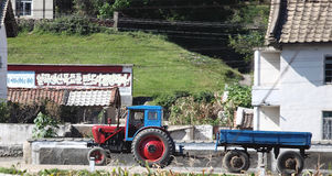 North korean village scenery. Here is the north korean village scenery on the way to Pyongyang.A tractor is traveling on the road in the countryside Royalty Free Stock Photography